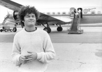 On tour, Micky Dolenz pauses for a moment after departing The Monkees' custom airplane to soak in the band's incredible success during the Summer of Love, 1967