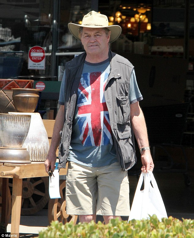 Shouldn't that be the stars and stripes? The Monkees Micky Dolenz wears a union flag T-shirt over Fourth of July Weekend